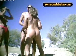 Swinger nudity seashore