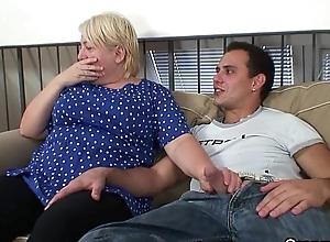 Juvenile guy helps venerable granny