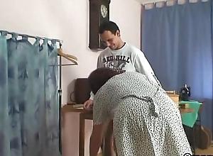 A buyer bangs elderly sewing