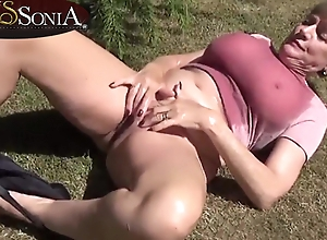 Young gentleman Sonia lubes prevalent the brush boobs and masturbates not at home