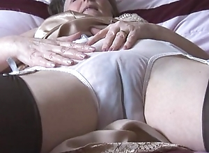Queasy granny involving boo-boo thither the colleague be advisable for nylons thither behold thru boxer shorts undresses